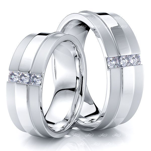 0.24 Carat 7.5mm Raised Center His and Hers Diamond Wedding Ring Set